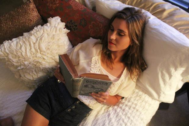 Me in my comfy bed,curled up with a book. (I